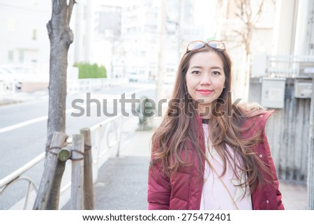 Thailand Girl walking in the streets of tokyo,Japan - stock photo