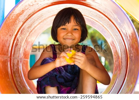 Thailand girls sat cheerfully colored tanks in the playground of the sole. - stock photo