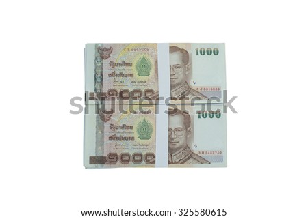 Thailand is a bundle of banknotes piled on a white background.