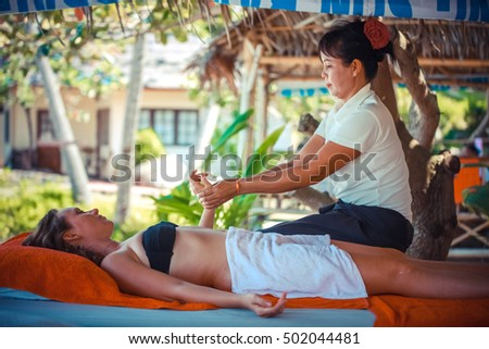 Thailand, Koh Samui, 4 january 2016. Day in beach spa. Thai woman doing massage