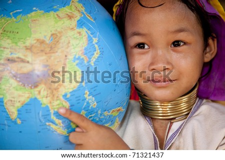 Thailand, Mae Hong Son, girl wih globe. - stock photo