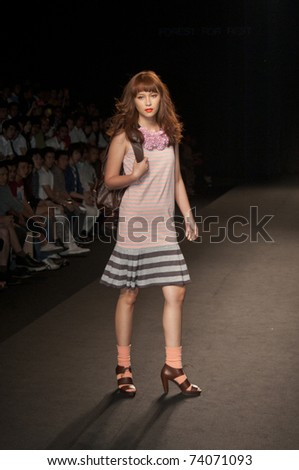 THAILAND -MAR 24 : A model is walking the runway at AB-NORMAL collection presentation for Fashion Networking during Bangkok International Fashion Week 2011 on March 24, 2011 in Bangkok,Thailand
