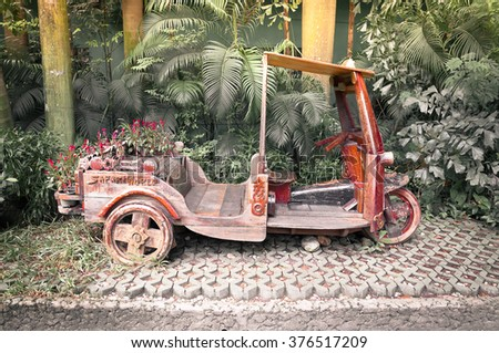 "thailand native taxi call ""tuk-tuk"" which make from the wood park in row - vintage retro looks. - stock photo"