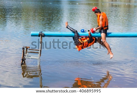 THAILAND - NOV 25 :Boxer on pipe with boxing gloves or martial arts gear fighting for winner on nature background at Loy Kra Thong Festival on NOV 25 2015, Loei province Thailand. - stock photo
