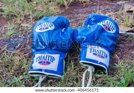 THAILAND - NOV 25  :boxing gloves or martial arts gear on a nature background prepare for boxer at Loy Kra Thong Festival on NOV 25 2015, Loei province Thailand. - stock photo