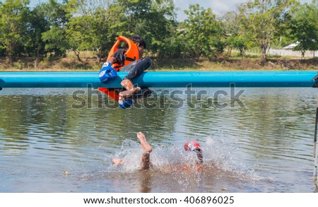THAILAND - NOV 25 :The winner Boxer on pipe with boxing gloves or martial arts gear fighting for winner on nature background at Loy Kra Thong Festival on NOV 25 2015, Loei province Thailand. - stock photo