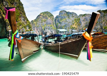 Thailand ocean landscape. Exotic beach view and traditional ship in Maya Bay, Ko Phi Phi Don - stock photo