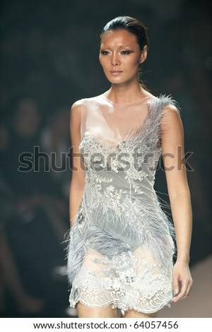 THAILAND - OCT 21 : A model is walking the runway at Kai collection presentation for Autumn/Winter 2010 during Bangkok International Fashion Week 2010 on October 21, 2010 in Bangkok,Thailand