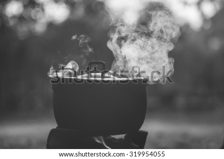 Thailand on September 24 th :It is the pot's steam with sunset's light at contryside of  Thailand on Sebtember 24th,2015 (selective focus,steam)