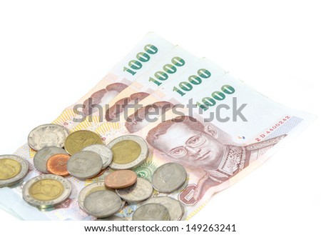 Thailand paper currency and coins isolated over white