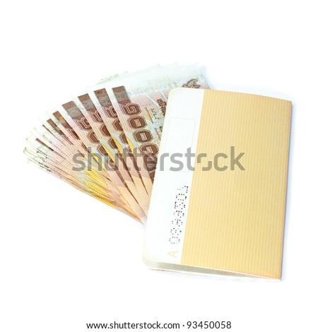 Thailand passbook and Thai money on white background. - stock photo