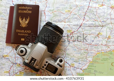 Thailand passport and camera on the map for World travel and travel asia  - stock photo
