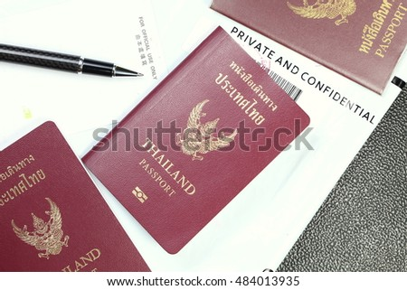 Thailand passport and document containing plastic bag represent the tourism and travel industry concept related idea. In the scene appear the chinese text meaning of for official use only.
