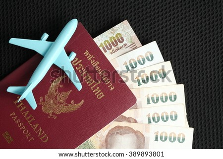 Thailand passport and thai baht currency banknote with blue color jet plane toy model represent the tourism and travel industry concept related idea.   - stock photo