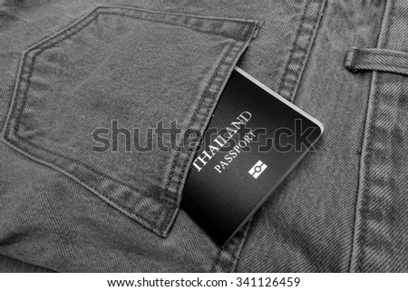 thailand passport in back pocket jean pants