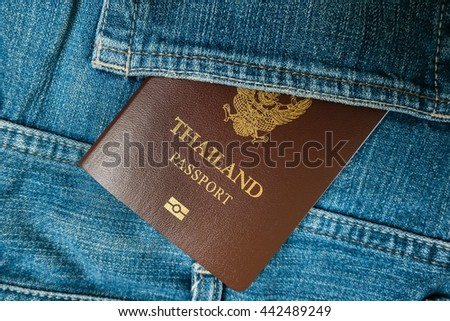 Thailand passport in blue jeans back pocket