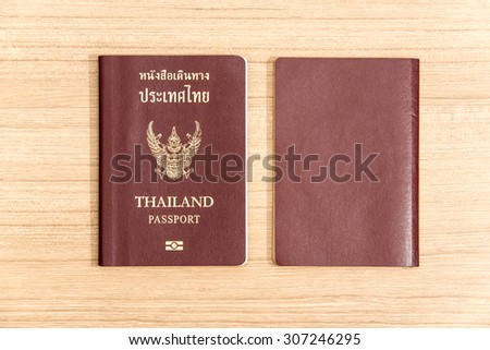 Thailand passport isolated an laminate flooring background. - stock photo