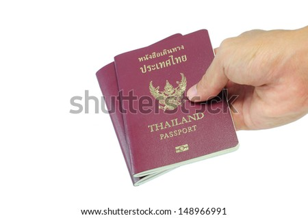 Thailand passport with hand isolated on white background