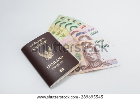 Thailand passport with Thai money ready to travel on white background