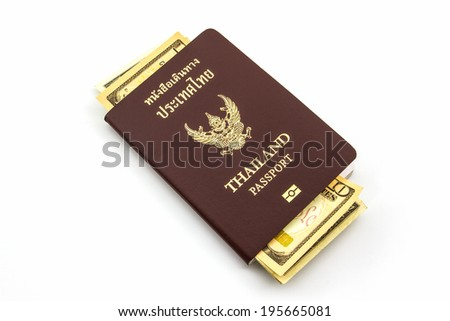 Thailand passport with U.S. Currency bank note on white background.