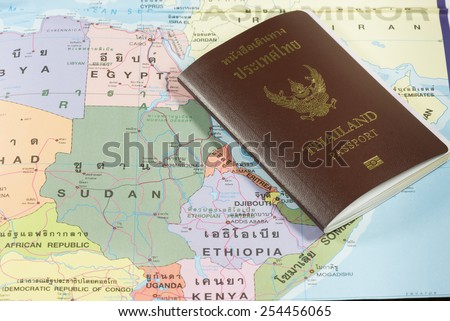 Thailand Passports on a map of the Ethiopia, Sudan and Egypt. - stock photo