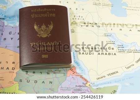 Thailand Passports on a map of the Saudi Arabia. - stock photo