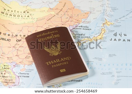 Thailand Passports on a map of the South Korea, North Korea and Japan. - stock photo
