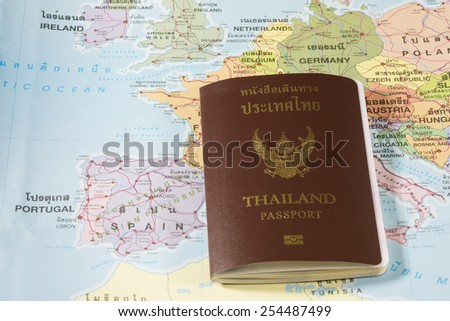 Thailand Passports on a map of the Spain,Germany and Portugal. - stock photo