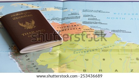 Thailand Passports on a map of the Venezuela. - stock photo