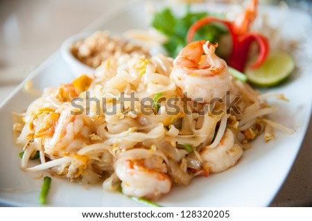 Thailand's national dishes, stir-fried rice noodles with egg, vegetable and shrimp (Pad Thai) - stock photo