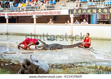 "THAILAND, SAMUT PRAKAN - March 26,2016 : ""crocodile show"" - stock photo"
