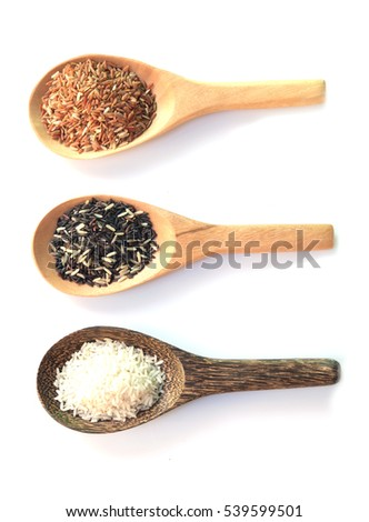 Thailand Thailand Riceberry grain rice in a wooden spoon Brown. On a white background
