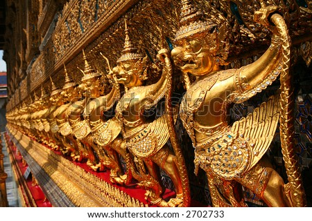 Thailand. The Grand Palace. Temple of the Emerald Buddha. Gold ornamental patter statuettes.
