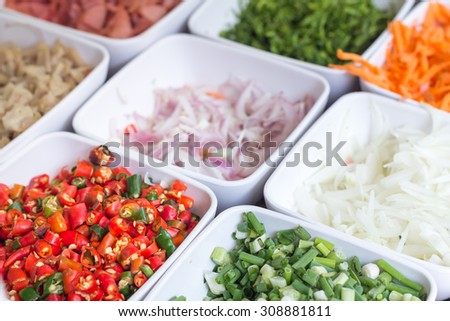 Thailand typical mixture of chili omelet,Onion,Pork chops, carrot,Basil and other ingredients - stock photo