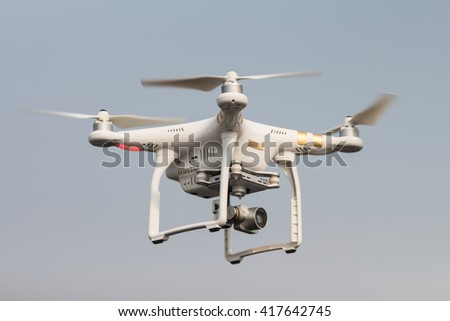 THAILAND UDONTHANI - APRIL 23 , 2016 : Drone flying helicopter with camera in blue sky.