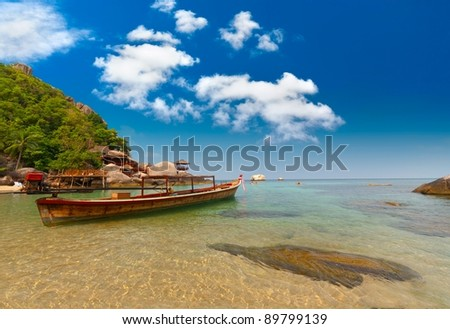 Thailand vacation bay with long-tailed boat - stock photo