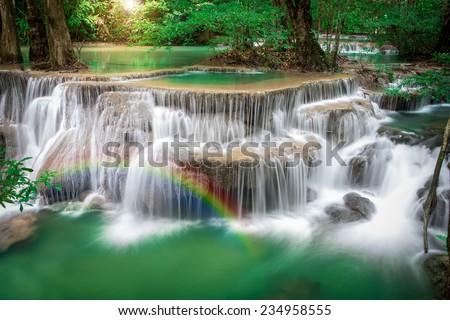 Thailand waterfall in Kanchanaburi (Huay Mae Kamin) with rainbows - stock photo