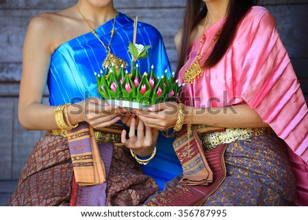 Thailand Women Thailand dressed in a beautiful holding krathong showing - stock photo