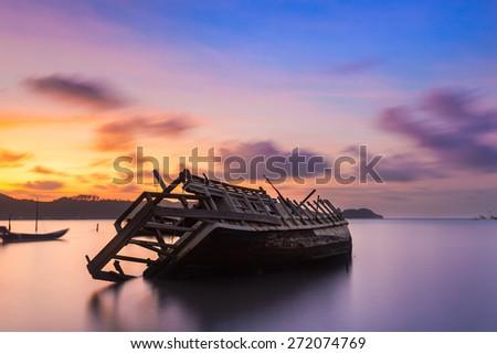thaiThe ship capsized sunrise Phuket thailand - stock photo