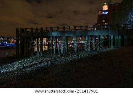 Thames beach during a low tide at night - stock photo