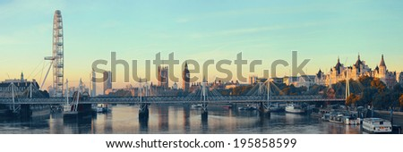 Thames River panorama with London Eye and Westminster Palace in London. - stock photo