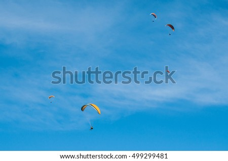 THAN - France - 16 October 2016 - group of paragliders on the sky