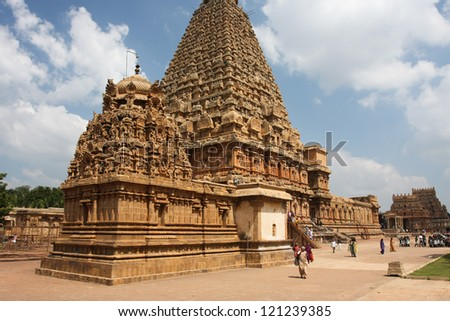 THANJAVUR, INDIA - JANUARY 23; Tourists walk around the ancient Brihadisvara Temple on January 23 2011 in Thanjavur India. Giant monolithic dome of the Temple weighing 81,3 tonnes. World heritage site