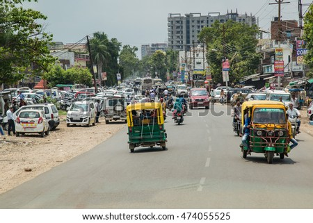 THANJAVUR, INDIA - JULY 18: Indian riders ride motorbikes on busy road on July 18, 2016 in Thanjavur, India. Motorbike is the most favorite vehicle and most affordable for India.