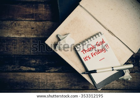 Thank God It's Friday word on pages sketch book on wood table vertical  - stock photo
