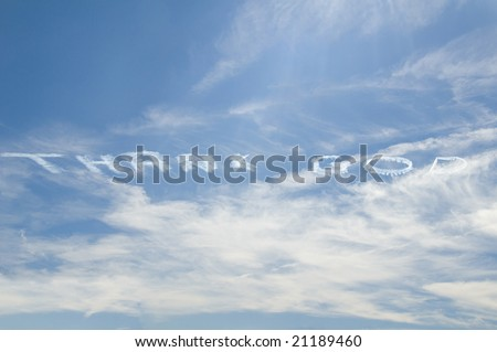 Thank God written in the sky by an airplane with blue sky on a partially cloudy day - stock photo