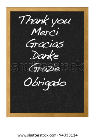 Thank in different languages written on a blackboard.