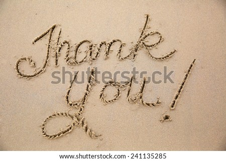 Thank you, a message written in the sand at the beach.  - stock photo
