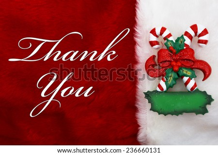 Thank You, A plush red stocking with a Candy Canes and words Thank You - stock photo