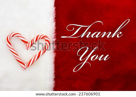 Thank You, A plush red stocking with a Candy Canes Heart and words Thank You - stock photo